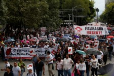 """Union workers and farmers protest as NAFTA renegotiation begins in Washington, D.C., in Mexico City, Mexico August 16, 2017. The placards read """" FTA hurts, Mexico better without FTA"""". REUTERS/Carlos Jasso"""